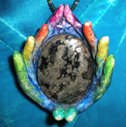 Carol Skylark Earth Hands pendant