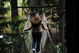 Cynthia Sue Larson on treehouse bridge